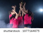 young female volleyball team... | Shutterstock . vector #1077164075