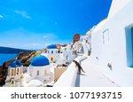 oia town on santorini island ...   Shutterstock . vector #1077193715