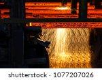 steel billets at torch cutting | Shutterstock . vector #1077207026
