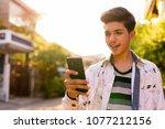 portrait of young handsome... | Shutterstock . vector #1077212156