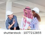 group of engineer checking the... | Shutterstock . vector #1077212855