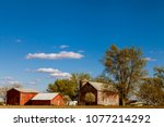 american farmland with blue... | Shutterstock . vector #1077214292