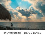 sunrise on a caribbean sea... | Shutterstock . vector #1077216482