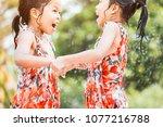 two asian little child girls... | Shutterstock . vector #1077216788