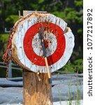 thrown axe in bullseye ... | Shutterstock . vector #1077217892