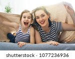 a nice girl and her mother... | Shutterstock . vector #1077236936
