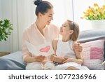 happy women's day  child... | Shutterstock . vector #1077236966