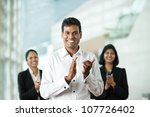 Group of successful Indian business people clapping good news - stock photo