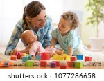 happy mom with lbaby son... | Shutterstock . vector #1077286658