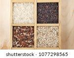 various rice in wooden box ... | Shutterstock . vector #1077298565