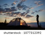 camping at dawn on top of... | Shutterstock . vector #1077312392