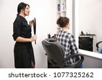 professional female hairdresser ... | Shutterstock . vector #1077325262