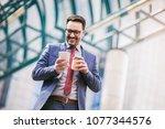 businessman using mobile phone... | Shutterstock . vector #1077344576