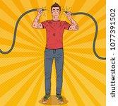 pop art man holding broken... | Shutterstock .eps vector #1077391502