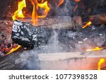 bright flame of wood burning in ... | Shutterstock . vector #1077398528