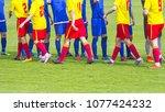 two soccer team handshake on... | Shutterstock . vector #1077424232