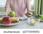 dieting and calories control... | Shutterstock . vector #1077459092
