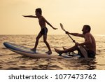 father and baby son playing on... | Shutterstock . vector #1077473762