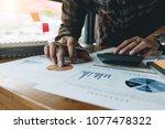 man calculating individual... | Shutterstock . vector #1077478322