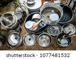 used pots  dishes  spoons is... | Shutterstock . vector #1077481532