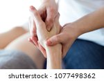 close up of physiotherapist... | Shutterstock . vector #1077498362
