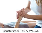 close up of physiotherapist...   Shutterstock . vector #1077498368
