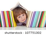 Mischievous kid with freckles and books playing - back to school concept - stock photo
