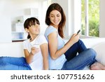 mother and daughter using...   Shutterstock . vector #107751626