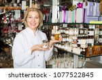 elderly woman selling gifts of... | Shutterstock . vector #1077522845