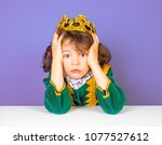 a photo of a surprised  shocked ...   Shutterstock . vector #1077527612