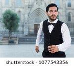 handsome emotional man in...   Shutterstock . vector #1077543356