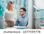 business partners working on... | Shutterstock . vector #1077559778
