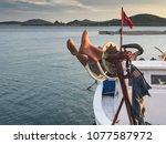 fishing boats moored at cunda... | Shutterstock . vector #1077587972