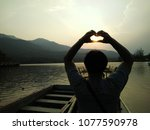 heart shape of hands against... | Shutterstock . vector #1077590978