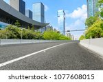empty asphalt road and modern... | Shutterstock . vector #1077608015