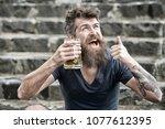 bearded man holds beer mug ... | Shutterstock . vector #1077612395