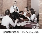 ordinary female waiter writing... | Shutterstock . vector #1077617858