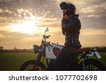 biker sitting on motorcycle and ... | Shutterstock . vector #1077702698