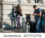 Small photo of Dublin, Ireland 09/13/2014- A young woman withdraw euros from an ATM machine in Dublin upon arrival.