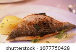 grilled fish fillet steak and... | Shutterstock . vector #1077750428