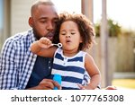 young black father and daughter ... | Shutterstock . vector #1077765308