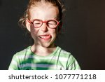funny girl in red glasses... | Shutterstock . vector #1077771218