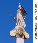 Small photo of Athena statue the ancient Greek goddess of science and wisdom, on crystal clear blue sky background