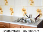 dirty dishes and unwashed... | Shutterstock . vector #1077800975