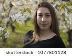 authentic girl looking at the...   Shutterstock . vector #1077801128