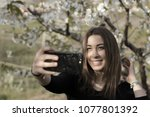 beautiful girl taking selfies...   Shutterstock . vector #1077801392