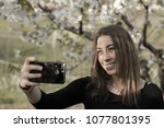authentic girl with a black t...   Shutterstock . vector #1077801395