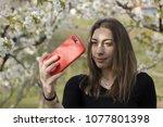 authentic girl taking a selfie. ...   Shutterstock . vector #1077801398