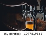 light draft cold beer pour in...   Shutterstock . vector #1077819866