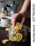 jar with bitcoin symbol cookies ... | Shutterstock . vector #1077843032